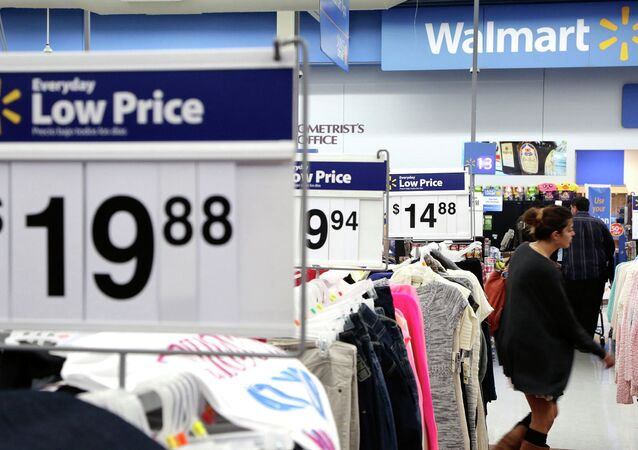 A woman shops at Walmart as the store prepares for Black Friday in Los Angeles, California November 24, 2014