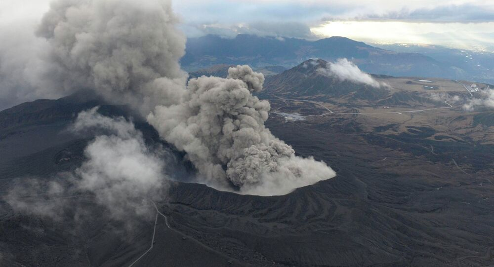 An aerial view shows volcanic smoke spew from Mount Aso in Aso, Kumamoto prefecture, southwestern Japan, in this photo taken by Kyodo November 26, 2014