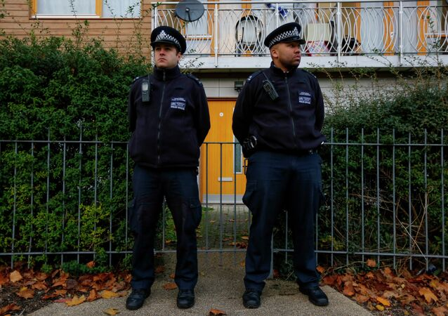 Police stand guard outside a South London