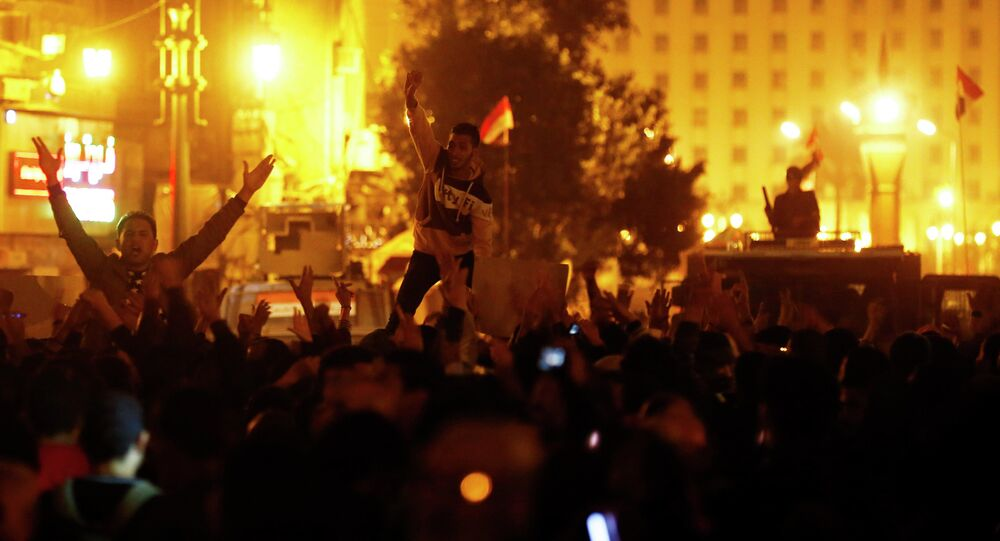 Anti-Mubarak protesters shout slogans against government and military rules after the verdict of former Egyptian President Hosni Mubarak's trial, around Abdel Moneim Riad square in downtown Cairo November 29, 2014