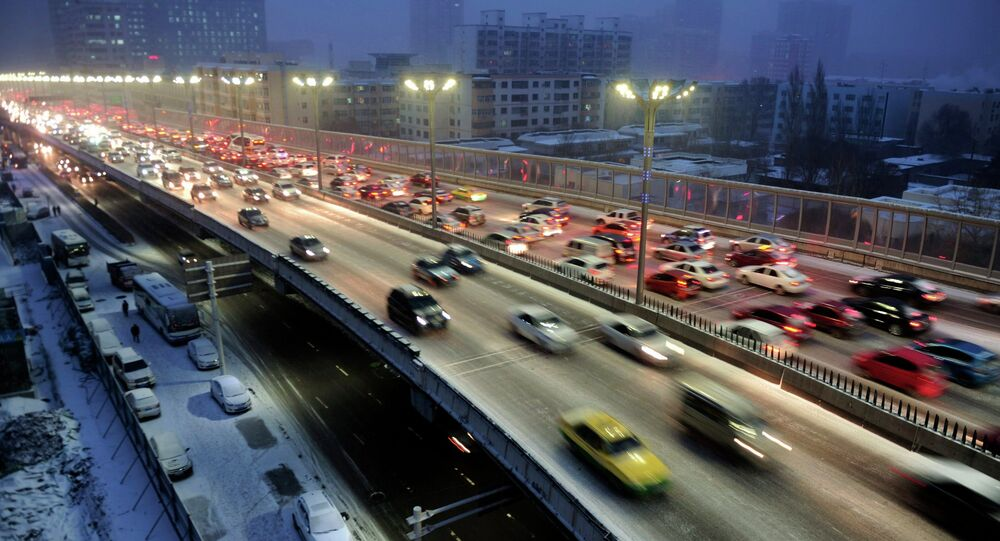 Cars drive along a bridge after snowfall in Urumqi, Xinjiang Autonomous region, November 28, 2014