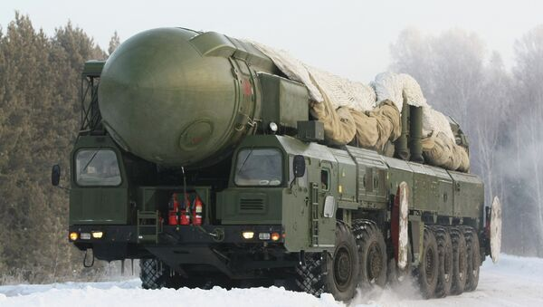 The RT-2PM Topol ballistic missile riding to the site of its permanent deployment with the Strategic Missile Forces of the Central Military Distric - Sputnik International