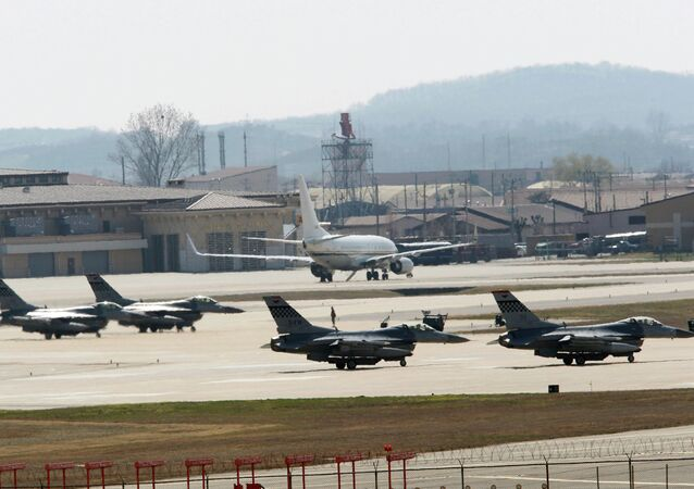 U.S. Air Force F-16 fighter jets wait to take off from a runway during a military exercise at the Osan U.S. Air Base in Osan, South Korea