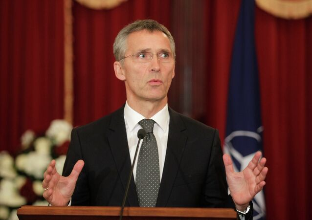 NATO Secretary General Jens Stoltenberg gestures as he speaks during a news conference in Riga