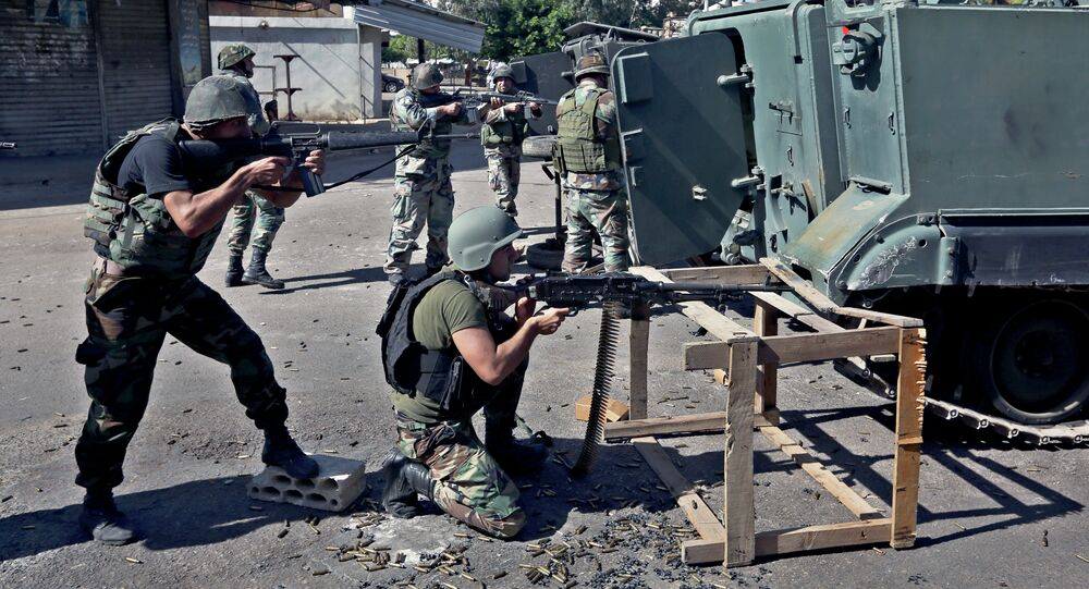Lebanese army soldiers open fire during clashes with Islamic militants in the northern port city of Tripoli, Lebanon.