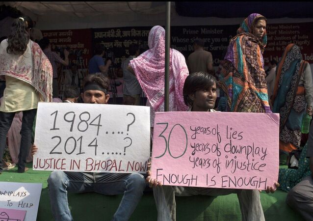 Bhopal gas tragedy survivors hold placards during a protest in New Delhi, India, Monday, Nov. 10, 2014