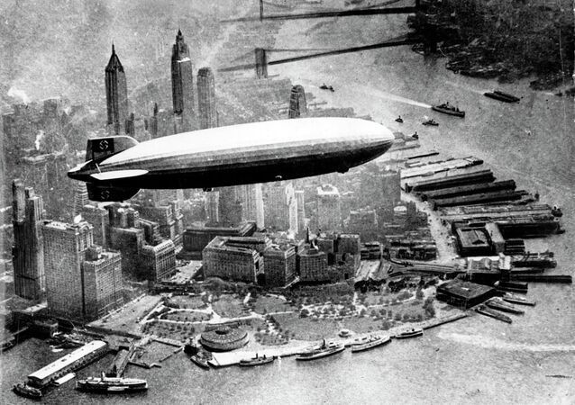 German airship 'Hindenburg' photographed from a plane, is seen flying over Manhattan Island, New York, USA in the 1930s.