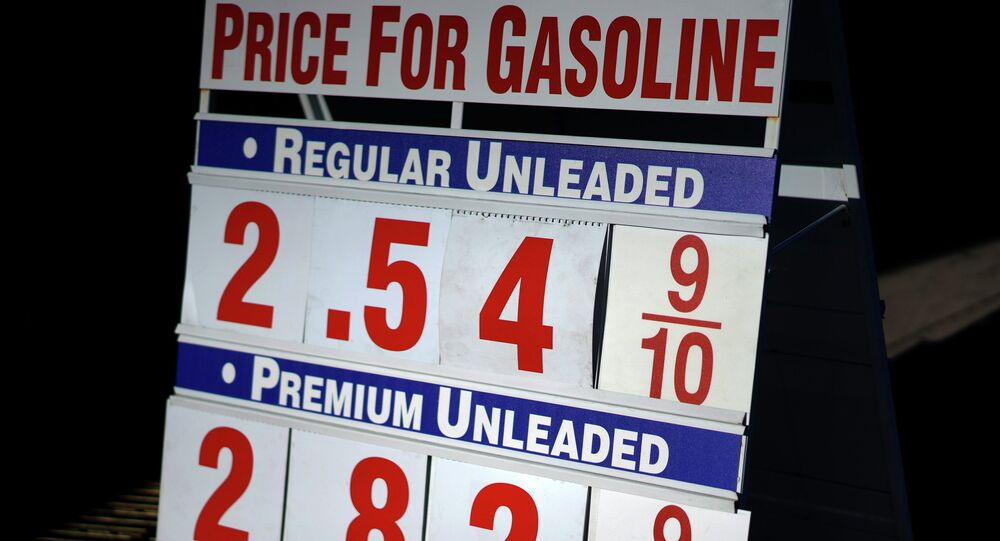 The gas prices are advertised outside the Costco store in Westminster, Colorado, December 2, 2014.