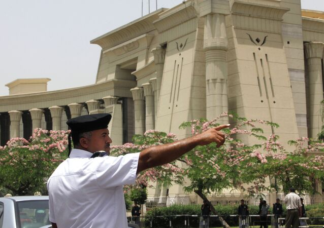 An Egyptian traffic policeman manages the traffic in front of the Supreme Constitutional Court in Cairo, Egypt