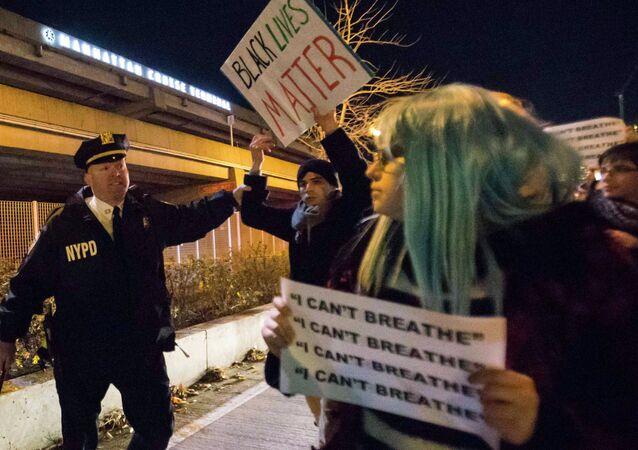 A policeman grabs a protester
