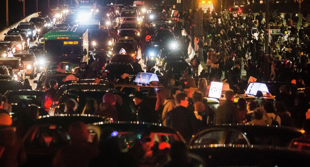 Protesters, demanding justice for the death of Eric Garner