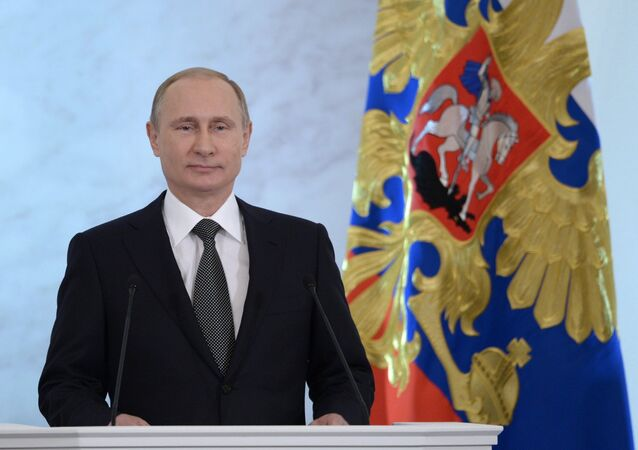 Russian President Vladimir Putin delivers the annual Presidential Address to the Federal Assembly at the Kremlin's St. George's Hall.