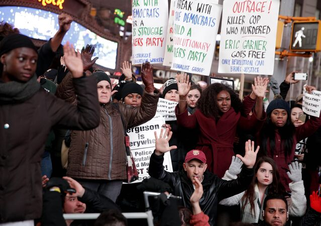 People participate in a protest in response to the grand jury's decision in the Eric Garner case in Times Square in New York