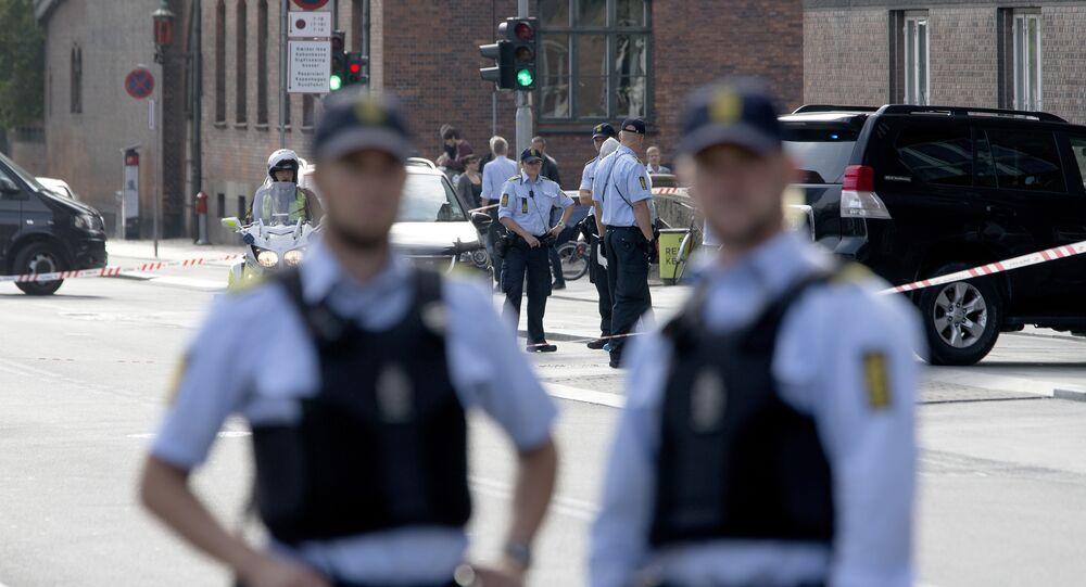 Police are seen outside Town Hall Square, Raadhuspladsen, in Copenhagen