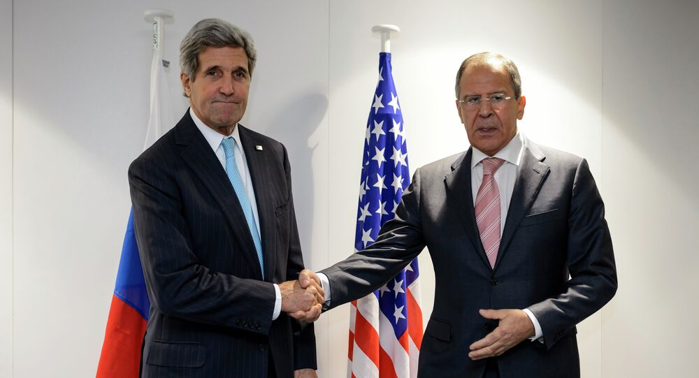 U.S. Secretary of State John Kerry (L) shake hands with Russia's Foreign Minister Sergey Lavrov at the meeting of foreign ministers from the Organization for Security and Cooperation in Europe (OSCE) in Basel