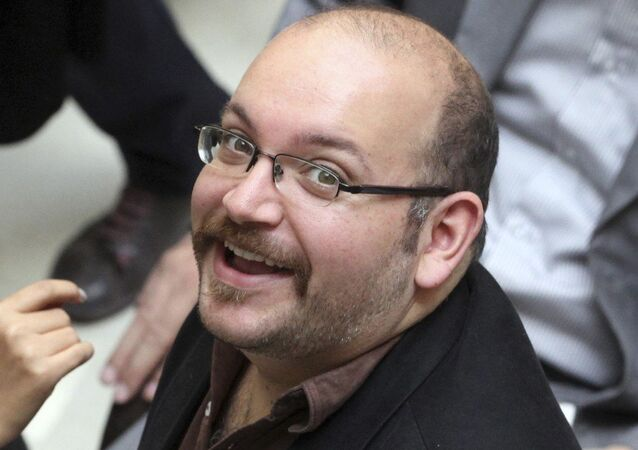 Jason Rezaian, an Iranian-American correspondent for the Washington Post smiles as he attends a presidential campaign of President Hassan Rouhani in Tehran, Iran. (File)