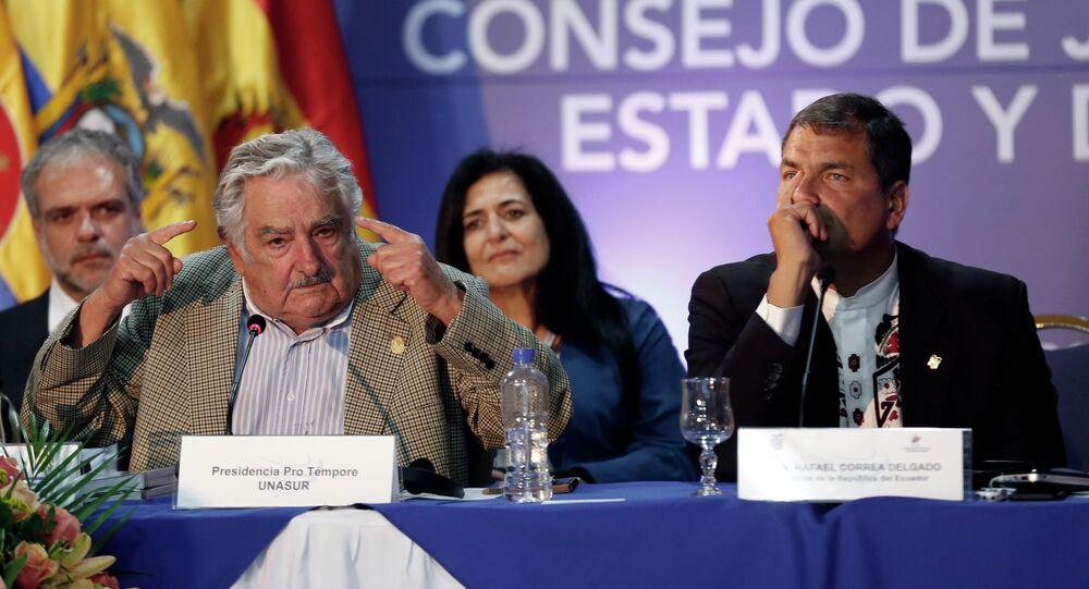 New UNASUR President Jose Mujica, President of Uruguay, left, speaks while Ecuador's President Rafael Correa, listens during the UNASUR summit in Guayaquil, Ecuador, Thursday, Dec. 4, 2014