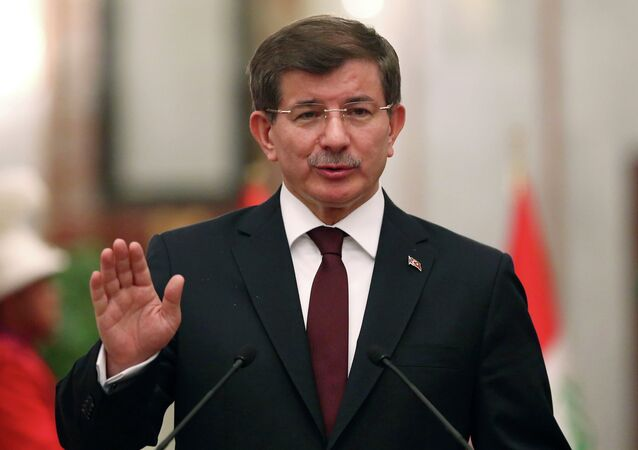 Turkey's Prime Minister Ahmet Davutoglu speaks at a news conference with Iraqi Prime Minister Haider al-Abadi (not pictured) in Baghdad, November 20, 2014