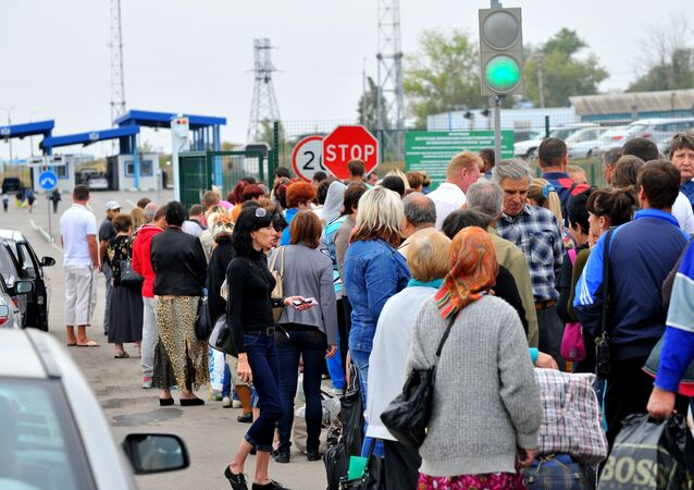 Ukrainian refugees at a border crossing point in the Rostov Region