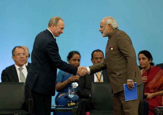 Russia's President Vladimir Putin, left, shakes hands with India's Prime Minister Narendra Modi