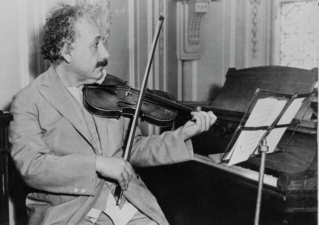 Famed physicist Albert Einstein is shown playing the violin, date and location unknown