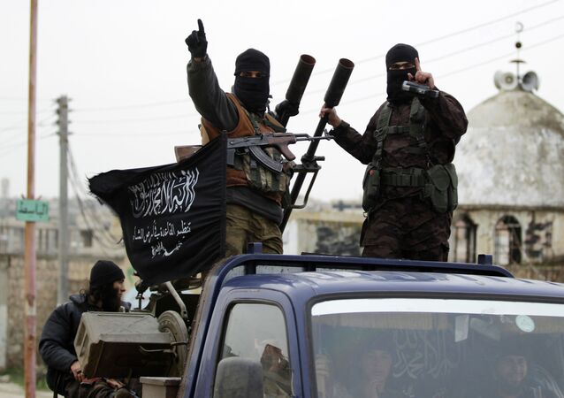 Members of al Qaeda's Nusra Front gesture as they drive in a convoy touring villages, which they said they have seized control of from Syrian rebel factions, in the southern countryside of Idlib, December 2, 2014