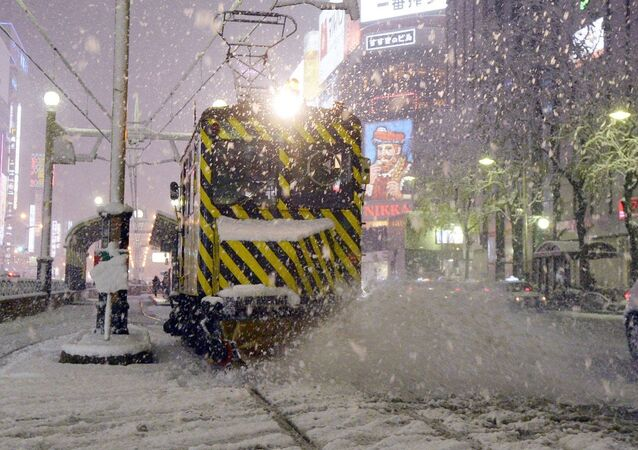 A snow plow known as the Sasara tram is at work on a snowy street in Sapporo on Japan's northernmost main island of Hokkaido on Nov. 13, 2014