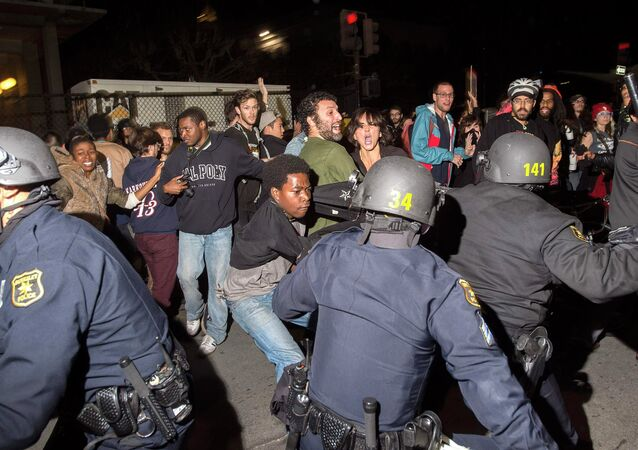 Police officers scuffle with protesters during a protest against police violence in the U.S., in Berkeley, California December 6, 2014