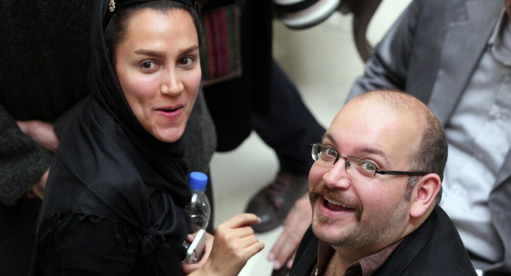 In this photo taken on April 11, 2013, Jason Rezaian, right, an Iranian-American correspondent for the Washington Post, and his wife Yeganeh Salehi
