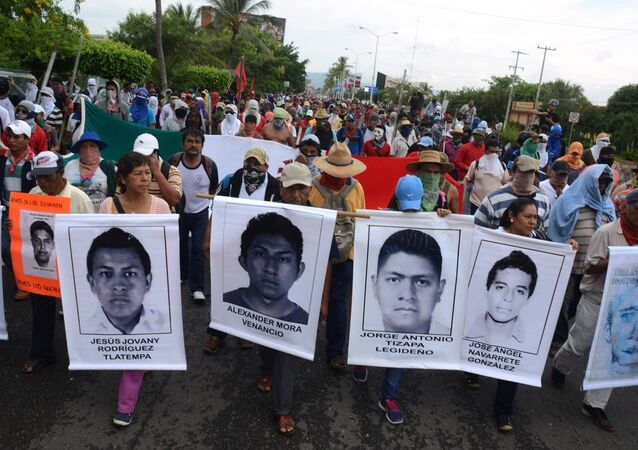 Students block access to the Acapulco airport to protest the disappearance, and probable murder, of 43 students in the state of Guerrero, Mexico, Monday, Nov. 10, 2014