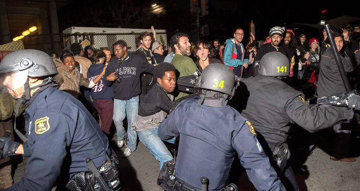 Police officers scuffle with protesters during a protest against police violence in the U.S., in Berkeley, California. More than five police vehicles suffered damage as several hundred protesters took to the streets before being dispersed with teargas.