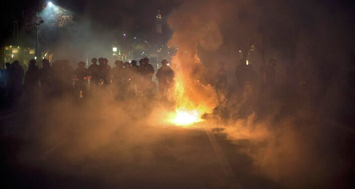 Police officers deploy teargas while trying to disperse a crowd comprised largely of student protesters during a protest against police violence in the U.S., in Berkeley, California early December 7, 2014.