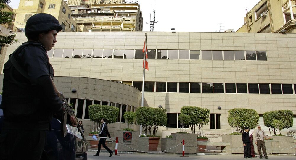 Security forces are deployed in front of the Canadian embassy in Cairo, Egypt, which closed to the public on Monday, Dec. 8, 2014