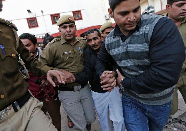 Policemen escort driver Shiv Kumar Yadav