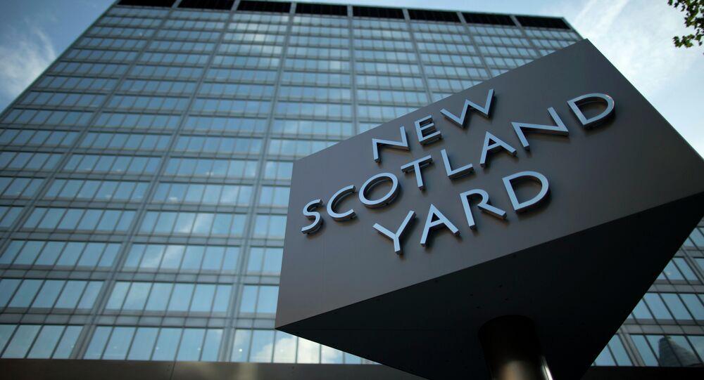 A sign rotates outside New Scotland Yard