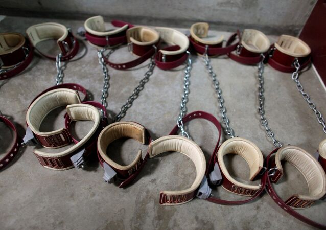 In this photo, reviewed by the US Military, aleg shackles pictured on the floor at Camp 6 detention center, at the US Naval Base, in Guantanamo Bay, Cuba