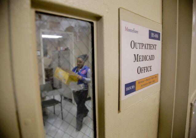 A Medicaid office employee works on reports at Montefiore Medical Center