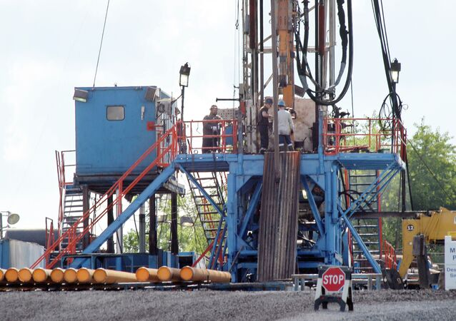 A crew works on a drilling rig at a well site for shale based natural gas in Zelienople