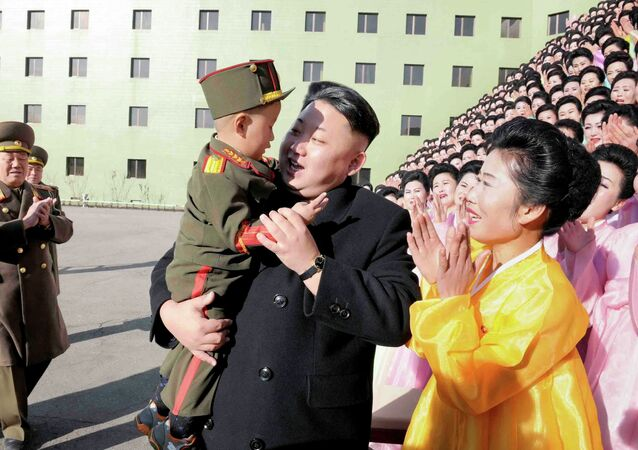 North Korean leader Kim Jong Un holds a boy after a photo session with participants in the Second Meeting of KPA Exemplary Servicemen's Families in this undated photo released by North Korea's Korean Central News Agency (KCNA) in Pyongyang