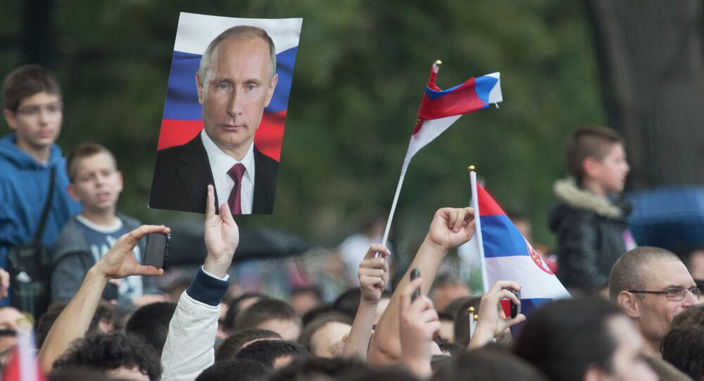 Residents of Belgrade with pictures of Vladimir Putin and Russian flags during Russian president's visit to Serbia on October 16, 2014.