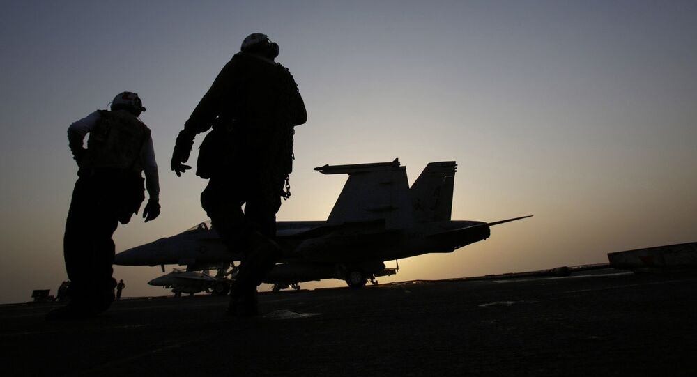 U.S Navy sailors work on aircrafts for missions targeting the Islamic State group in Iraq from the deck of the U.S