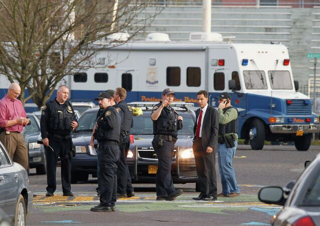 Police investigate outside the Rosemary Anderson High School in Portland, Oregon December 12, 2014