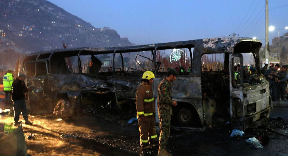 Afghan security forces inspect at the site of a suicide attack in Kabul December 13, 2014. A suicide bomber destroyed a bus carrying Afghan soldiers in the capital Kabul on Saturday, the defence ministry said, but there was no immediate confirmation of casualties from the latest in a series of strikes on targets in and around the city.