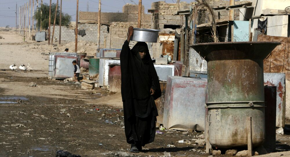 A woman carries a vessel