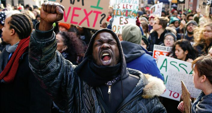 People shout slogans against police as they take part in a march against police violence, in New York December 13, 2014