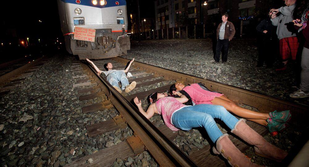 Protesters block an Amtrak train in Berkeley, Calif., on Monday, Dec. 8, 2014