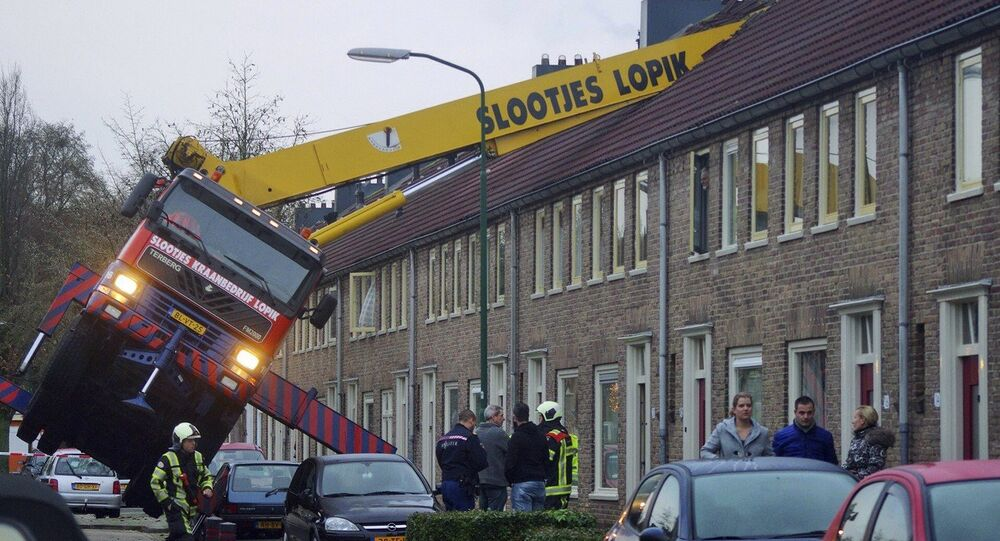 A crane which crashed into the roof of a house