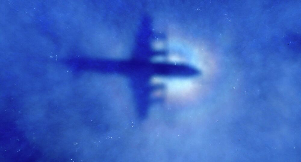 The shadow of a Royal New Zealand Air Force (RNZAF) P3 Orion  looking for missing Malaysian Airlines flight MH370