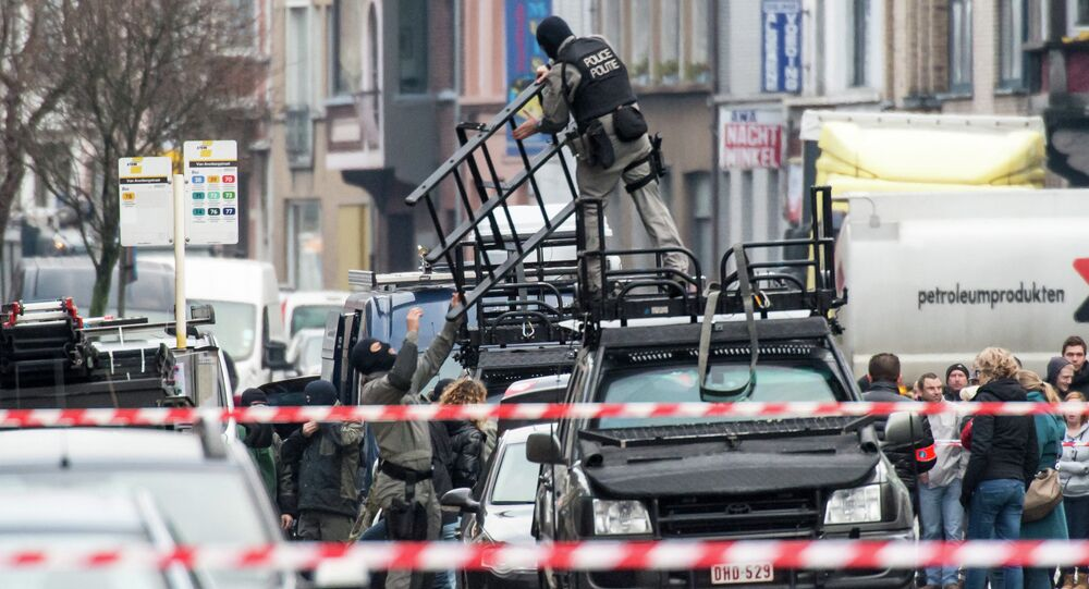 Special forces police install special equipment on a van, in Ghent, western Belgium, Monday, Dec. 15, 2014