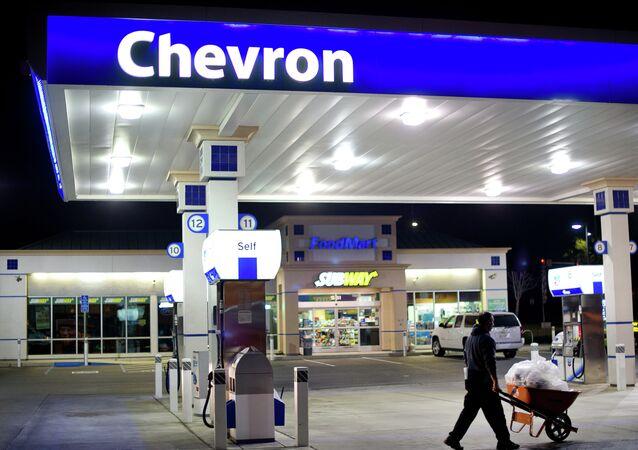 A night worker hauls garbage at Dixon Landing Chevron